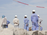 Workers on a Project to Reclaim Land from the Sea for Hotel Development in Dubai Photographic Print by Ashley Cooper
