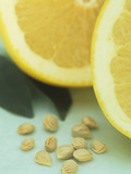 Grapefruit Slices and Seeds Photographic Print by Wally Eberhart