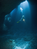 Scuba Diver Exploring the Blue Hole Cave, Micronesia, Palau Photographic Print by Reinhard Dirscherl