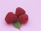 Three Kilarney Raspberries and Leaf, a Source of Vitamin C and Fiber Photographic Print by Wally Eberhart