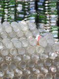 Glass Bottles and Plastic Containers Collected for Recycling Photographic Print by Ashley Cooper