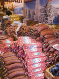 German Sausages in a Christmas Decorated Market, Manchester, UK Photographie par Ashley Cooper