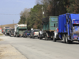 Row of Trucks Entering the Charleston County Landfill, Charleston, South Carolina, USA Photographic Print by Marc Epstein