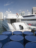 Luxury Yachts and Oil Barrels in Dubai Photographic Print by Ashley Cooper