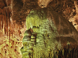 Caveman, Stalactites and Flowstone Formations Photographic Print by Adam Jones