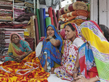Indian Women in Cloth Shop, Udaipur, India Photographic Print by Adam Jones