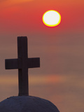 Cross on Church at Sunset over the Ocean, Mykonos, Greece Photographic Print by Adam Jones