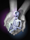 A Small Gray Alien Like Fetus Being Held Photographic Print by Victor Habbick