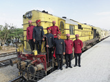 Staff Members for the Palace on Wheels Train Posing with the Train, Udaipur, India Photographic Print by Adam Jones