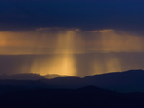 Late Afternoon Sunlight Illuminates Rainfall over Distant Hills Photographic Print by Michael Johnson
