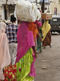 Colorful Indian Women in Traditional Saris Leaving Market in Udaipur with Containers on their Heads Photographic Print by Adam Jones