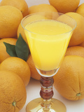 Oranges and a Refreshing, Healthy Glass of Fresh Squeezed Orange Juice Photographic Print by Wally Eberhart