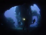 Divers at the Entrance to Second Cathedral Formation, Lanai, Hawaii, USA Photographic Print by David Fleetham