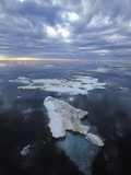 Melting Chunk of Brash Ice Showing the Large Underwater Portion, Beaufort Sea, Arctic Ocean Photographic Print by Chris Linder