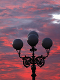 Street Light Silhouetted at Sunrise, Florence, Italy, Tuscany Photographic Print by Adam Jones