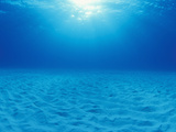 Shallow Underwater Sand Plain Lit by the Sun Through Clear Blue Water, Bahamas Photographic Print by Michael Johnson