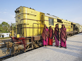 Young Indian Women Posing in Front of Palace on Wheels Train Parked at Train Station, Udaipur Photographic Print by Adam Jones