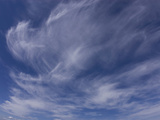 Cirrus Clouds Sweep across a Deep Blue Sky Photographic Print by Michael Johnson