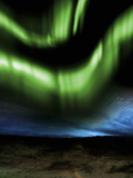Illustration of the Aurora Borealis over Distant Hills at Night Photographic Print by Victor Habbick