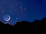 Crescent Moon with Earthshine Above a Cloud Layer with the Constellation Orion Photographic Print by David Nunuk