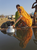 Women Gathering Water in Buckets from an Open Water Well, Pushkar Fair, India Photographic Print by Adam Jones