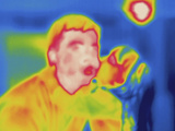 Thermogram - Child Kissing Father Photographic Print by Chuck Swartzell