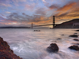 A Low Tide, Sunset View of Waves Crashing onto the Rocky Coast on the Shore of San Francisco Bay Photographic Print by Patrick Smith