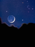 Crescent Moon with Earthshine and the Constellation Orion Photographic Print by David Nunuk