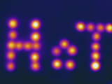 Thermogram - Warmed Stones Arranged to Spell the Word Hot Photographic Print by Chuck Swartzell