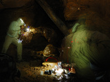 Two Speleologist Photographing in the Deep Darkness of a Cave, Italy Photographic Print by Fabio Pupin