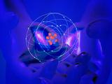 Hands Cradling an Atom Photographie par Carol & Mike Werner