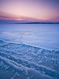 Tracks in the Snow and Ice of Lake of Two Mountains at Sunset, Montreal, Quebec, Canada Photographic Print by Robert Servranckx
