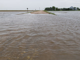 Agricultural Flooding from a Thunderstorm Covers a Rural Road in Western Nebraska Photographic Print by Jon Van de Grift