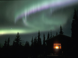 Aurora Borealis on a Cold Winter Night over a Cabin in the Taiga, Alaska, USA Photographic Print by Tom Walker
