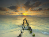 Sunset Behind an Old Eroded Pier Extending into the Ocean Near Cancun, Mexico Photographic Print by Patrick Smith