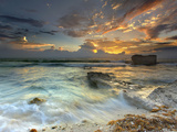 Coastline on Isla Mujeres, Mexico Showing Waves and Eroded Rocks under Cloudy Skies at Sunset Photographic Print by Patrick Smith