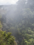 Volcanic Fog (Or &quot;Vog&quot;) Reduces Visibility and Partially Obscures a Ravine in Hawaii, USA Photographic Print by Jon Van de Grift