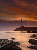 A Lighthouse and Wave Action at Sunset on the Rocky Shore Just South of Pigeon Point Photographic Print by Patrick Smith