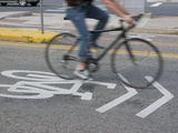 A Cyclist Riding on an Urban Street, Boulder, Colorado, USA Photographic Print by Jon Van de Grift