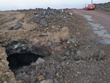 A Collapsing Lava Tube Threatens the Stability of a Road on the Side of a Volcano in Hawaii Photographic Print by Jon Van de Grift
