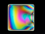 A Plastic Box Lid Viewed Between Crossed Polarizers Shows Interference Colors Photographic Print by Loren Winters