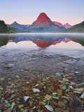 Dawn Light Sets the Peaks Aglow over Misty Two Medicine Lake, Glacier National Park, Montana, USA Photographic Print by Geoffrey Schmid