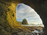 Wispy Cirrus Clouds and a Seastack Seen Through Hole in the Wall Accessible Only at Low Tide Photographic Print by Geoffrey Schmid