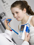 Pediatrician Examining a Girl and Taking Her Temperature Photographic Print by  Scientifica