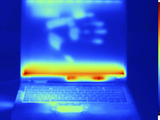 Thermogram of a Laptop Computer with a Thermal Shadow of a Hand on its Screen Photographic Print by  GIPhotoStock