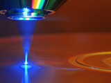 Blue Laser Reading or Writing a Blu-Ray Disc Photographic Print by  GIPhotoStock