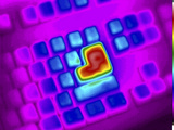 Thermogram of Hot Enter Key on a Computer Keyboard Photographic Print by  GIPhotoStock