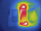 Thermogram - Electrical Light Switches - Middle Switch Is in Use Photographic Print by  Scientifica