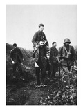 A German Infantry Soldier with a Wounded Leg Is Carried from Battle by English Prisoners of War Giclee Print by  German photographer