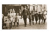 A Bobby on the Beat Helping Children across the Street at the End of the School Day Giclee Print by  English Photographer